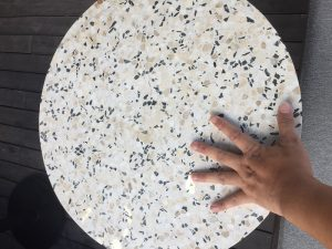 white terrazzo bar top table